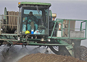 Tractor spraying soil